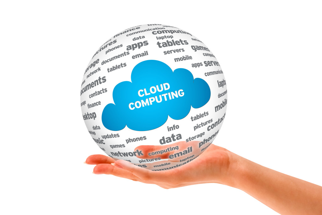 Hand holding a Cloud Computing Sphere isolated on white background.