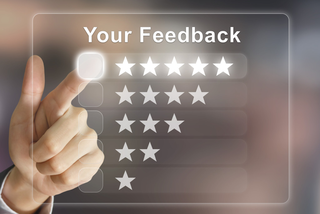 business hand clicking your feedback on virtual screen interface